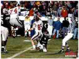 1n 1997, Cory Peterson, in an epic end to the Egg Bowl, caught the go-ahead two-point conversion that gave the Rebels a 15-14 win. (Photo Courtesy of Ole Miss Athletics)
