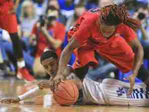 Stefan Moody scrambles for a loose ball in the Rebels' loss to Kentucky. (Photo credit: Carrier-Journal.com)