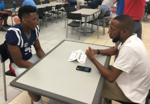 DaMarkus Lodge speaks with The Rebel Walk's Courtney Smith at Monday's Media Day. (Photo credit: Evelyn Vanpelt, The Rebel Walk)