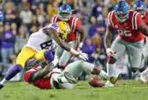 Victor Evans causes the LSU fumble that was picked up by Marquis Haynes. (Photo credit: Dan Anderson, The Rebel Walk)