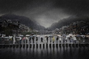Fenghuang Town in Hunan, also known as the Phoenix Town, is a tourist attraction in China. I capture tourists walking and braving the rain, and picturing the poetic charm of southern China.