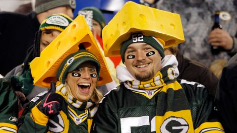 Two Green Bay Packers fans wear cheese head hats and cheer for their team during the NFL week 10 football game against the Minnesota Vikings on Monday, November 14, 2011 in Green Bay, Wisconsin. The Packers won the game 45-7. (AP Photo/Paul Spinelli)