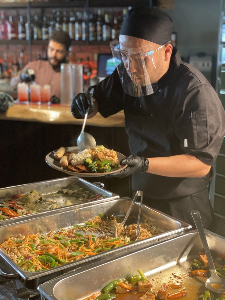 Thai restaurant owner serves food with PPE
