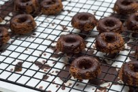 gluten free dairy free bittersweet chocolate doughnuts on cooling rack