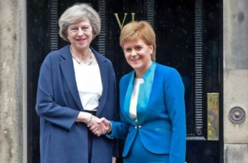 Britain's new Prime Minister Theresa May (L) is greet by Scotland's First Minister Nicola Sturgeon (R) as she arrives for talks at Bute House, in Edinburgh, on July 15, 2016. Theresa May visited Scotland for talks with the First Minister less than 48 hours after taking office as British prime minister. / AFP PHOTO / Lesley MartinLESLEY MARTIN/AFP/Getty Images