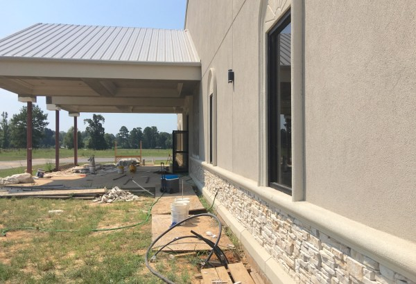 Continuing to work on the stucco and stone outside the church