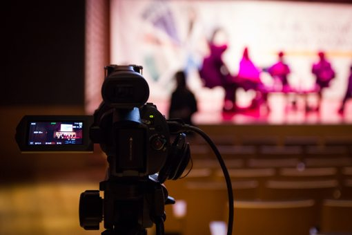 Video camera pointed at a conference stage