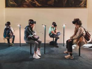 A group of people sitting down using VR