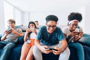 Group of friends playing a mobile game