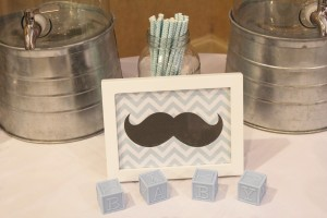 Mustache themed baby shower beverage station