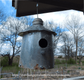 Repurposed birdhouse made from an old chimney flu, old hardware and flashing