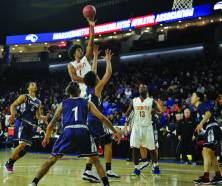 Isaiah Likely, whose all-around excellence has been key to Everett's postseason success, skies through the lane during the Crimson Tide's 68-56 victory in Saturday's Div. 1 North Final.