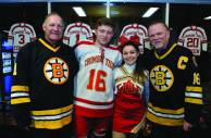 Jason Suppa and cheerleade4r Alexia Arloro are pictured with Bruins greats Reggie Lemelin and Rick Middleton.
