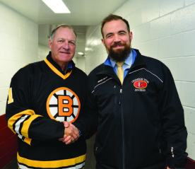 Former Bruins goaltender Reggie Lemelin is pictured with Crimson Tide head coach Erick Kainen.