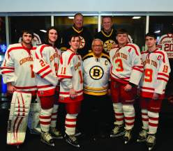 Bruins greats Reggie Lemelin and Rick Middleton (back) and Hall of Famer Johnny Bucyk are pictured with Everett High senior hockey players Brendan Calderon, Kevin O'Brien, Nathan Johnson, Ryan Colman, and Jason Cardinale.