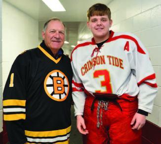 Former Bruins goaltender Reggie Lemelin is pictured with Everett High School senior Ryan Colman