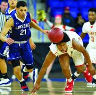 Isaiah Likely (1) chases down a loose ball during Saturday's win over Lawrence.