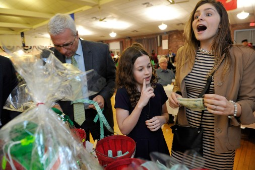 Katherine Drozdick, 12, and Stephanie Hogan, 16, were excited to bid on raffle items at the Friendly Friends of St. Patrick 59th Annual Saint Patrick's dinner at the Edward G. Connolly Center. Also pictured his Everett School Committee member Frank Parker.