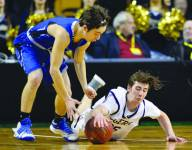 Pope John's Cam Erickson (35) dives to the TD Garden's parquet floor for a loose ball.