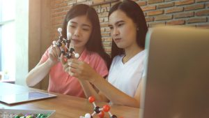 Two girls learning STEM careers in chemistry