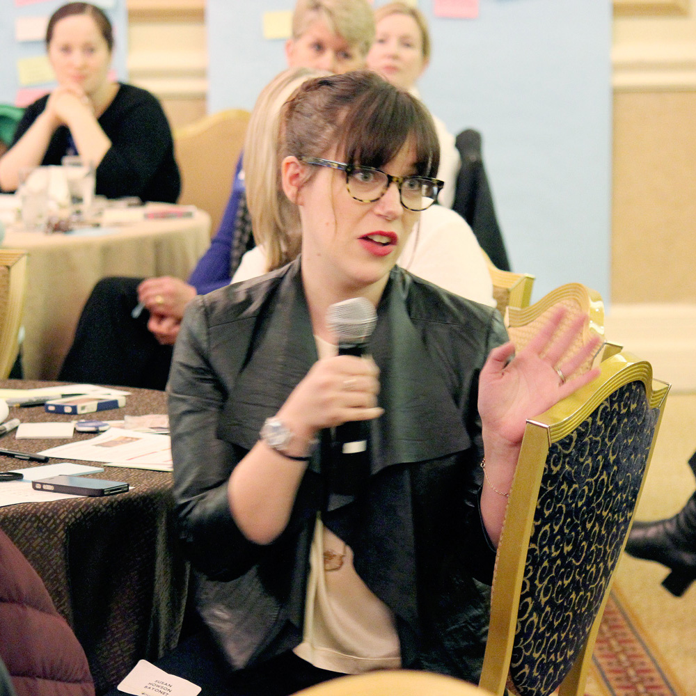 Woman asking question at conference