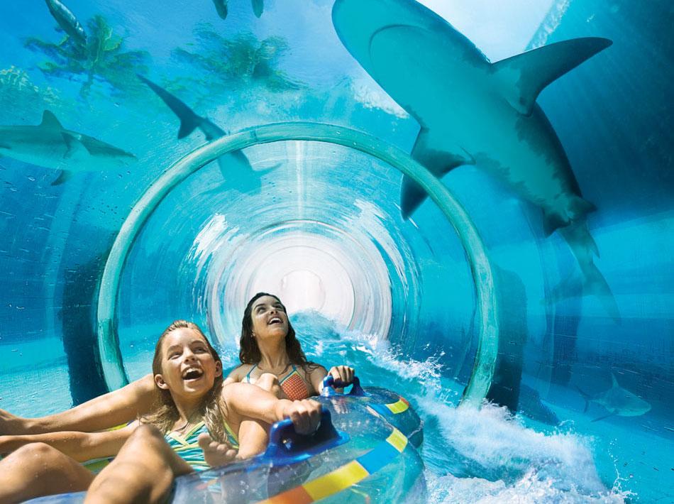 Girls on innertube in tunnel