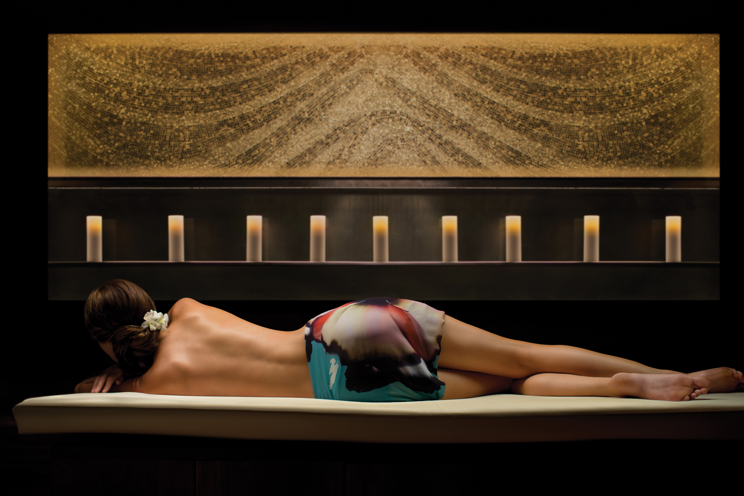 Woman lying on bed in spa