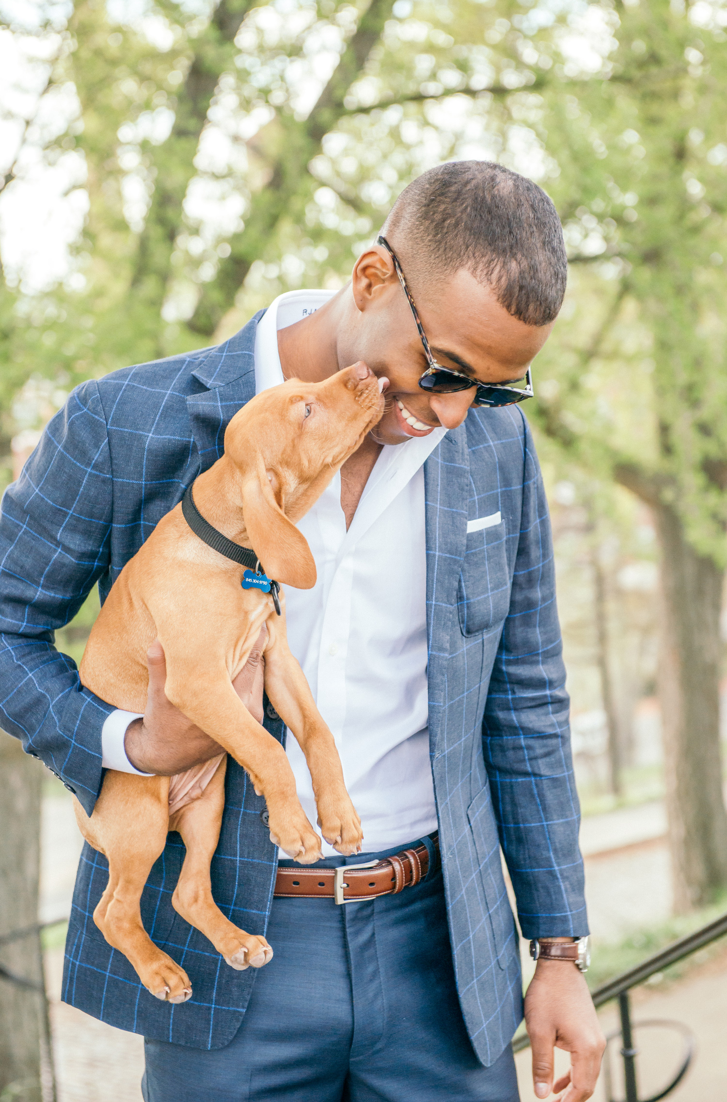Man in suit with puppy