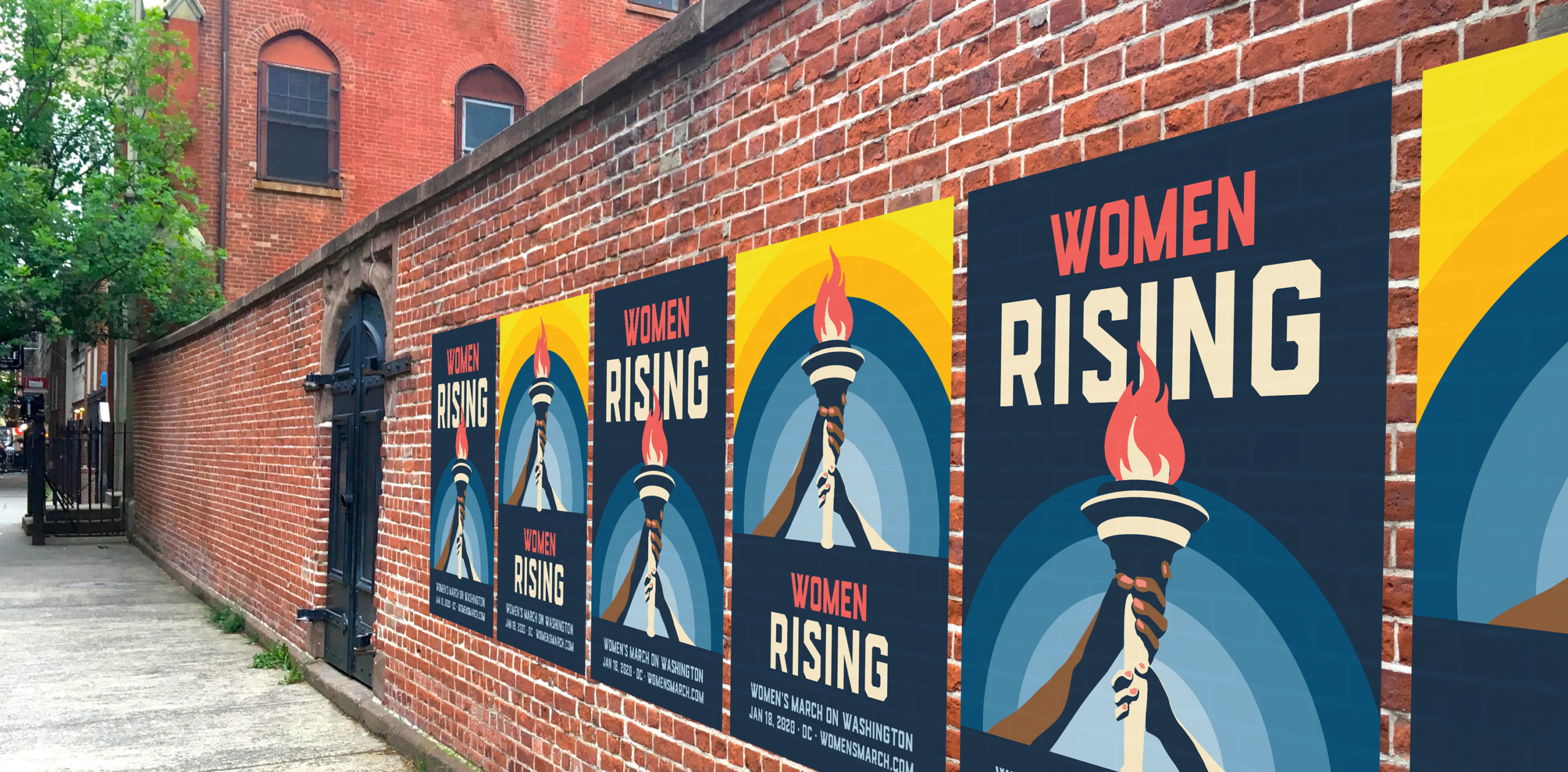 Women's March posters on brick wall