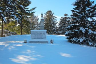 Memorial War Marker covered with snow in November