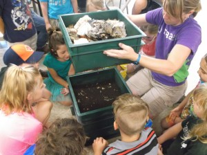 Exploring the contents of a worm bin to learn about healthy soil
