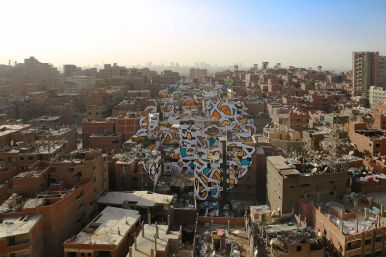 eL Seed's mural in Cairo across multiple buildings