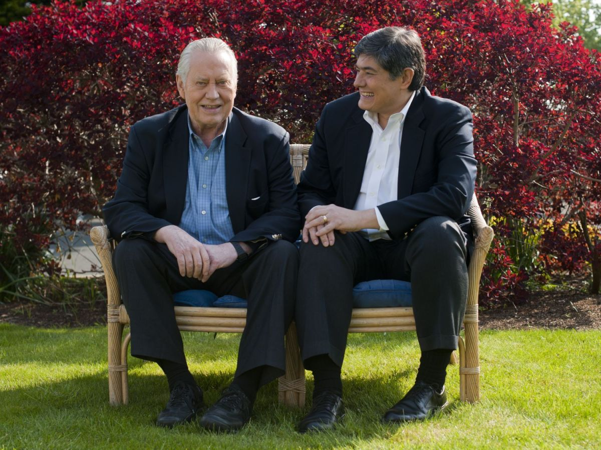 Chuck Feeney sitting next to his CEO in a garden
