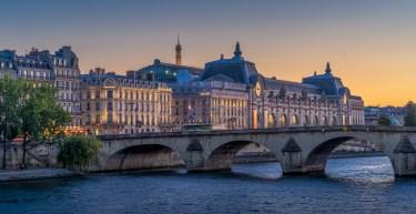 A Paris scene featuring a bridge crossing the River Seine