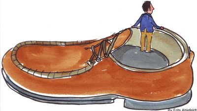 Image: Tiny Man in a big shoe