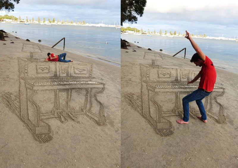 Image: A piano drawn in the sand and a man pretending to play it