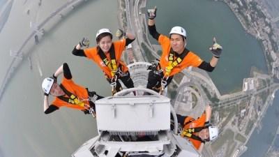 Image: People climbing high tower