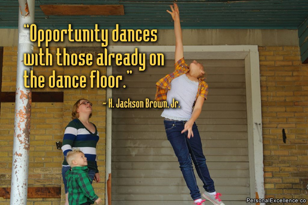 "Image: Girl jumping with the saying ""Opportunity dances with those already on the dance floor."""