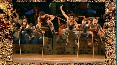 Image: Stomp performance with the performers all holding brooms