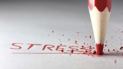 "Image: Red colored pencil breaks drawing the word ""stress"""
