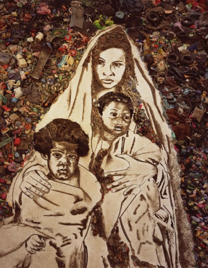 Image: Woman and children in garbage