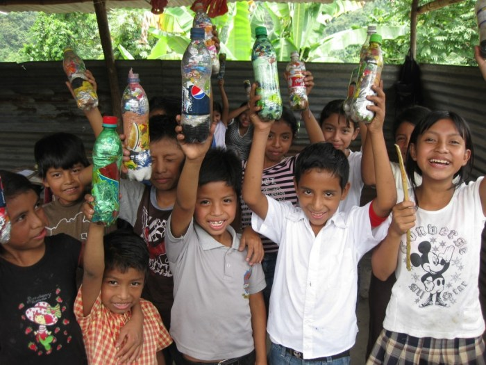 Image: Kids standing with plastic bottles