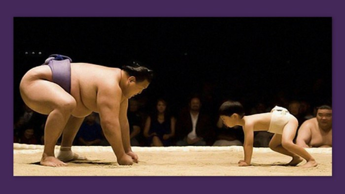 Image: A huge sumo wrestler facing off against a much smaller opponent...a child!
