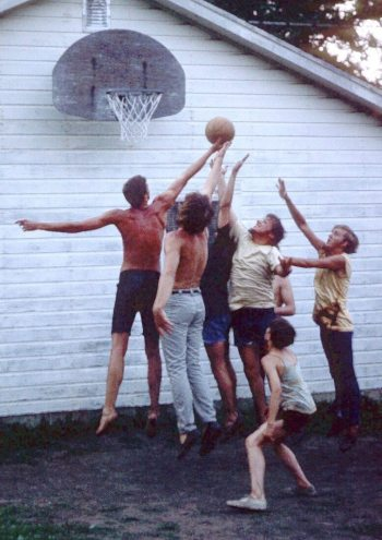 Image: Chuck with his brothers and friends playing basketball