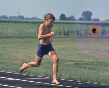 Image: Dr. Chuck barefoot running on a cinder track