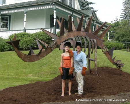 Image; Lynda and Louisa in front of their giant metal sculpture.