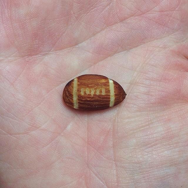 Image: Almond cut to look like a football, Brock Davis Photography
