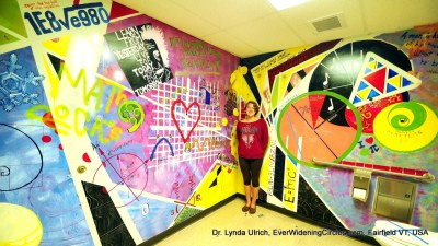 Image: Artist Louisa Ulrich-Verderber paints her math teachers' bathroom