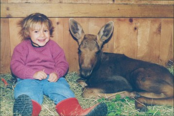 Image: Liesl and a baby moose, stories of compassion and animal rehabilitation