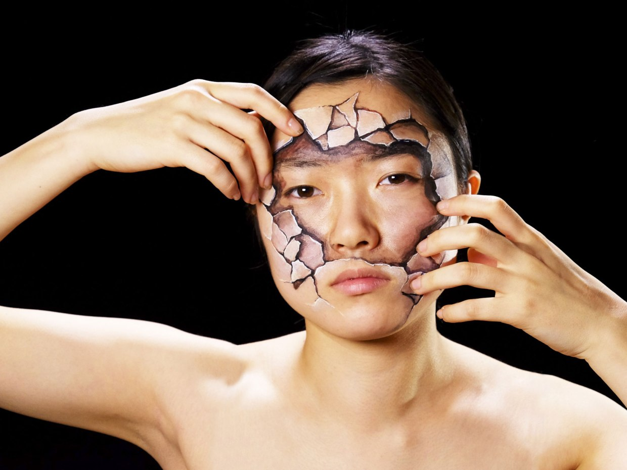 Image: face painted to look like broken pieces of pottery by Hikaru Cho